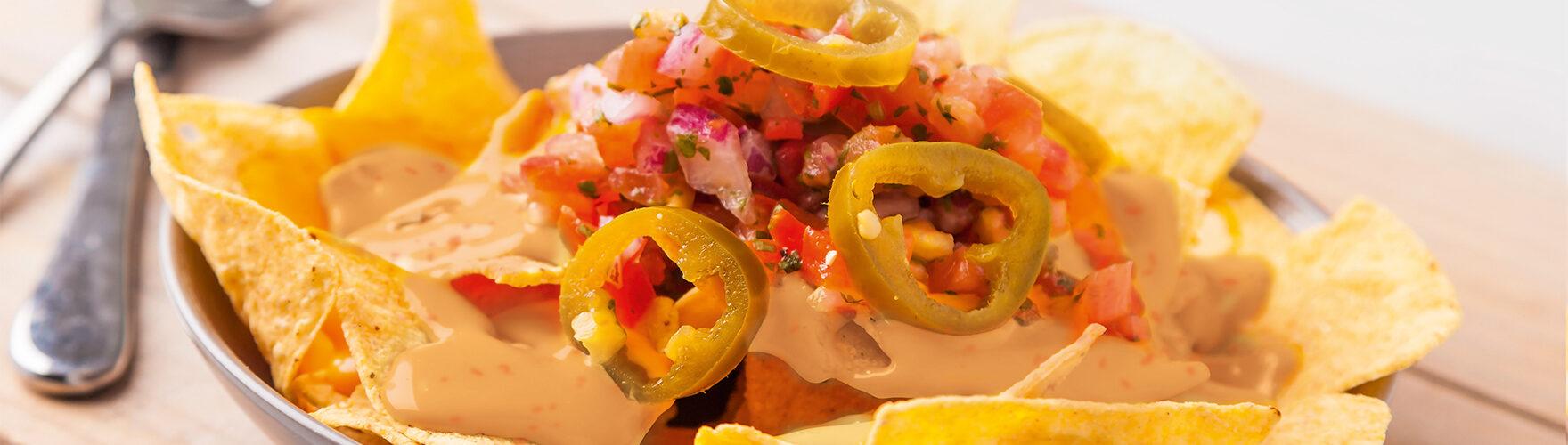 Tortilla nachos with tomato, onion and sambal