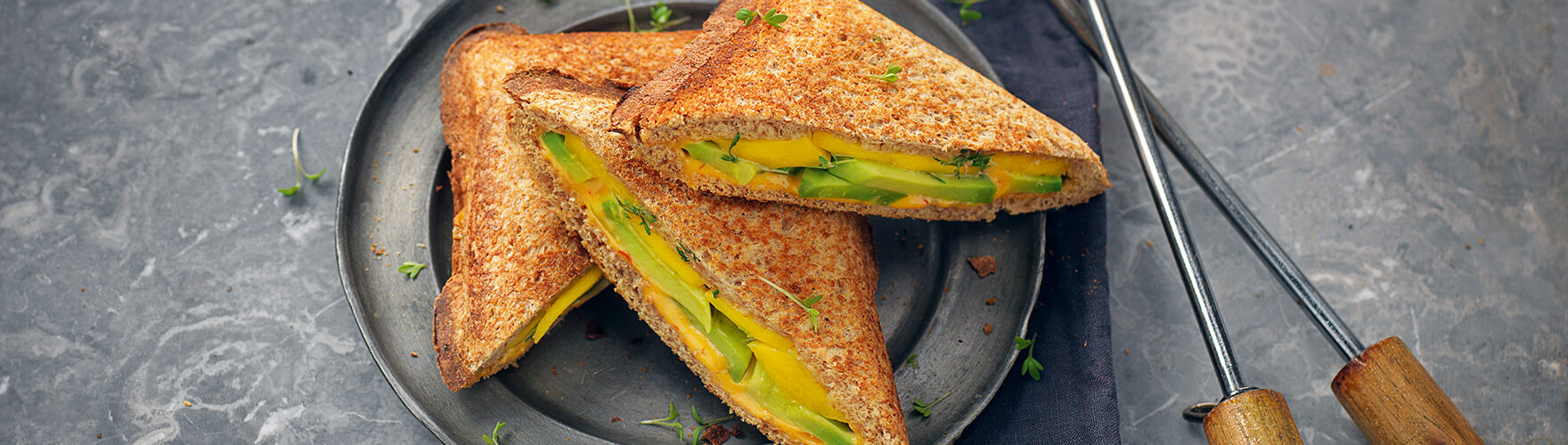 Toastie with cheddar, avocado, mango, cress and sambal