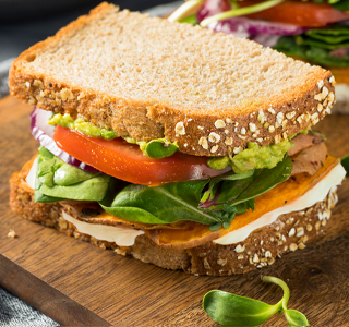 Sandwich with sweet potato, tomato and avocado