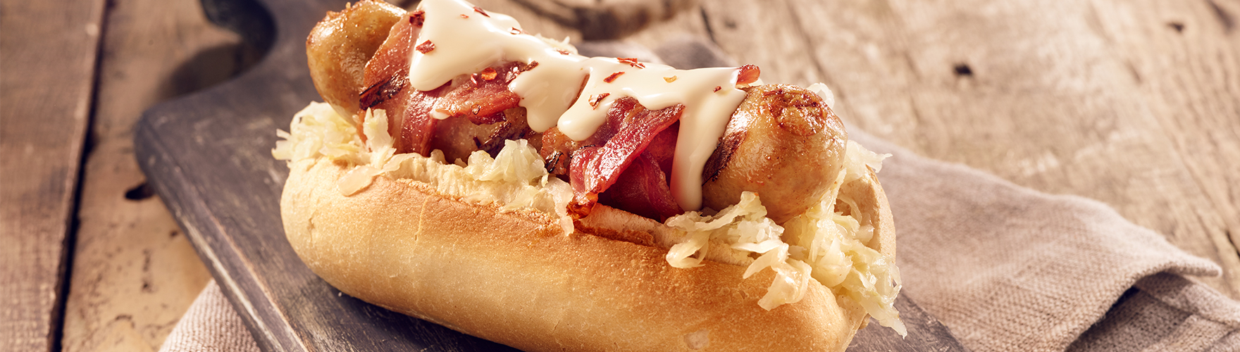 Hot dog with sauerkraut and bacon