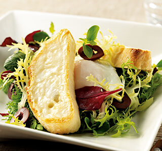 Salad, served with crostini with ERU Spreadable Goat Cheese and a poached egg